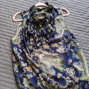 Sleeveless blouse high collar